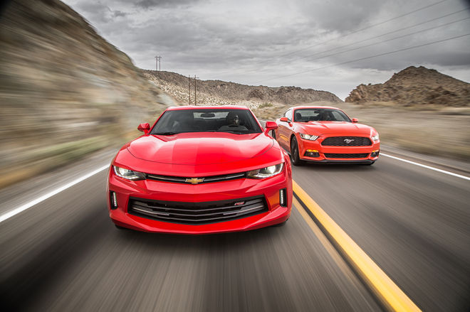 2016-Chevrolet-Camaro-RS-2016-Ford-Mustang-EcoBoost-front-end-in-motion