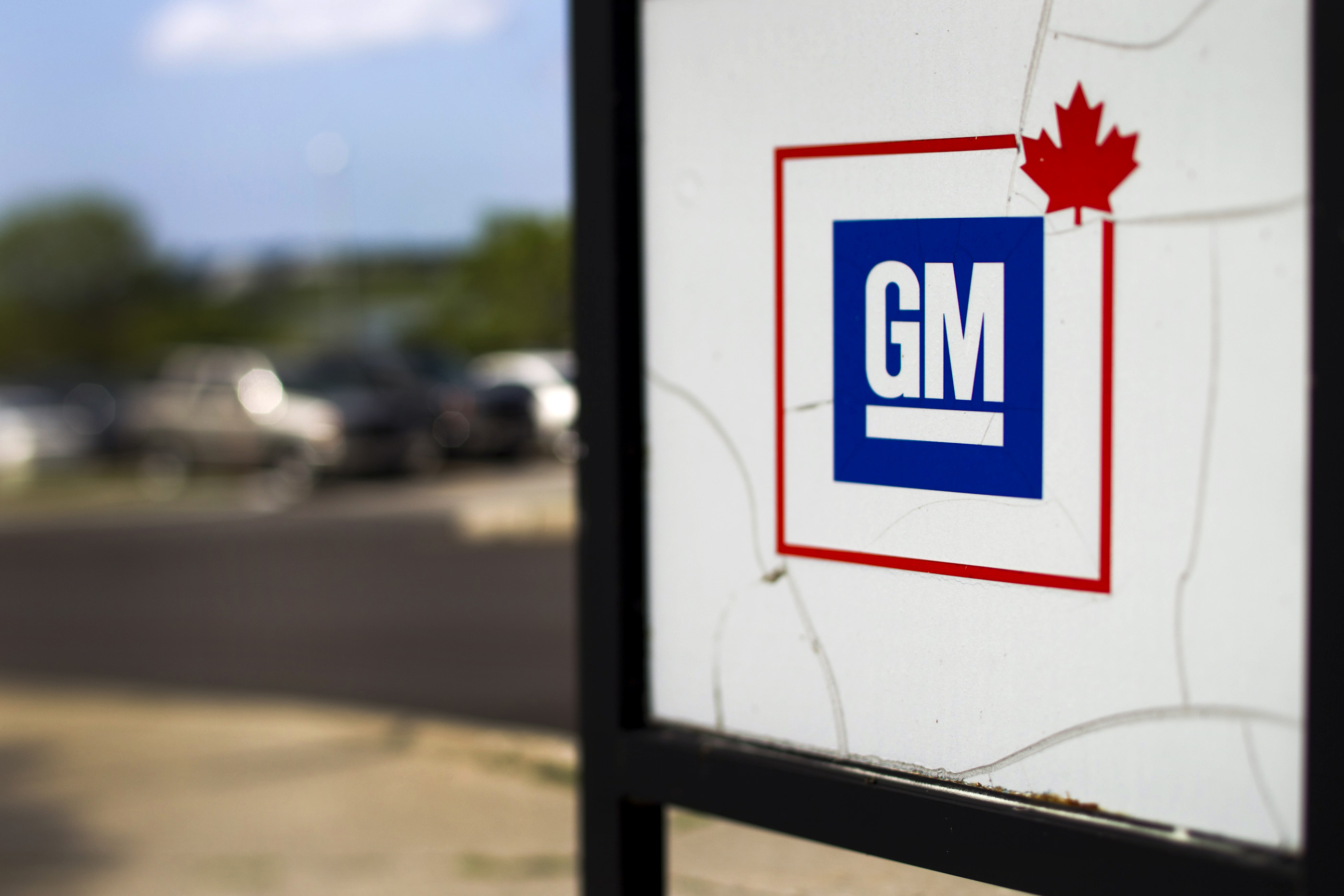 General Motors Co. (GM) signage is displayed outside of General Motor of Canada Ltd. headquarter offices in Oshawa, Ontario, Canada, on Monday, Aug. 8, 2011. General Motors of Canada Ltd. will pump $2.535-billion into a trust fund that will finance health-care costs for its retirees, eliminating a key legacy cost that the auto maker said hobbled it in the fiercely competitive North American auto market, according to The Globe and Mail. Photographer: Brent Lewin/Bloomberg via Getty Images